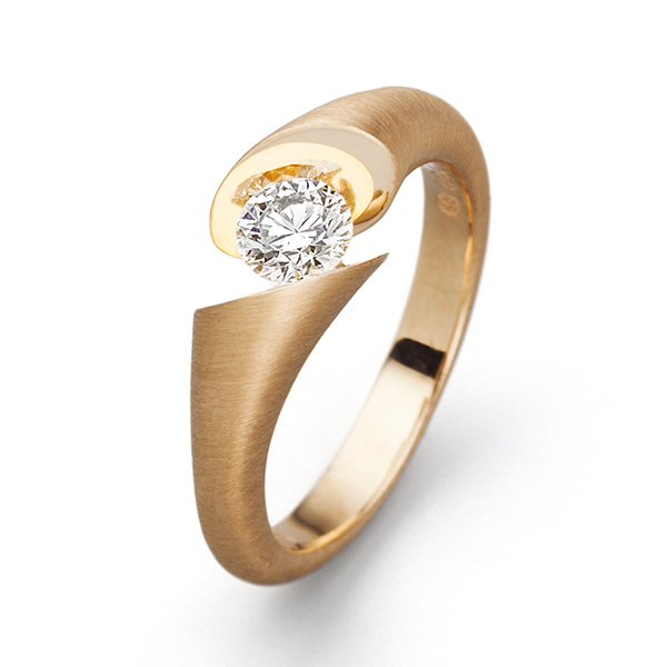 Designer: Schaffrath<br/>Style: Calla Ring<br/>Metal: 18 karat yellow gold<br/>Stone: 0.67 round brilliant, hearts and arrows ideal cut. G color, VS Clarity.<br/>Size: 5.5 US