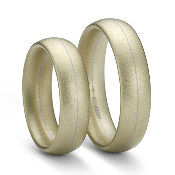 Designer: Niessing <br/>Style: 'Soul' Ring<br/>Metal: 18-karat ivory and grey gold<br/>Width: 6 mm Height: 2.3mm<br/>Finger Size: 59.5 metric, 9 US
